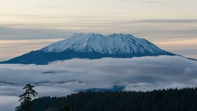 Time lapse video of white clouds over snow covered Mt St Helens in WA state 4k stock video footage