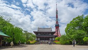 Time Lapse video of Zojoji Temple with Tokyo Tower in Tokyo city, Japan timelapse 4K.  stock video footage