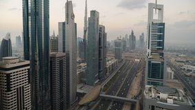Time Lapse of view down skyscraper lined Sheikh Zayed Road at dusk stock video footage