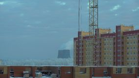 Time lapse view of industrial urban background in winter in the evening. Industrial landscape with smokestacks pollute. Time lapse view of industrial urban stock video