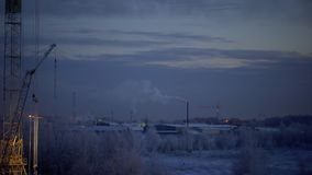 Time lapse view of industrial urban background in winter at the night. Industrial landscape with smokestacks pollute. Time lapse view of industrial urban stock video