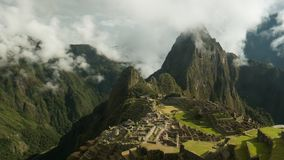Time lapse view of Machu Picchu on a misty morning