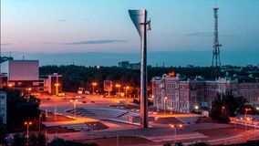 Time lapse. Beautiful sunset overlooking Stella, the main monument of the city of Rostov-on-Don, view from the roof