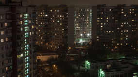 Time lapse view of sleeping buildings and complexes with yard and road, Moscow, Russia. Time lapse night view of typical old sleeping district with residential stock video