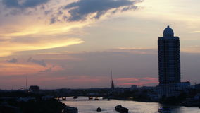 Time-lapse View of sunset over chaophraya river bangkok Thanlabd stock video footage