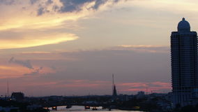 Time-lapse View of sunset over chaophraya river bangkok Thanlabd,zoom effect stock footage