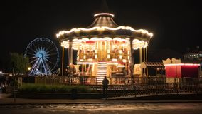 Time lapse of the vintage children`s carousel illuminated at night stock video