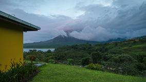 Time lapse of the volcano of Arenal. Covered in clouds during sunset. Costa Rica stock video footage