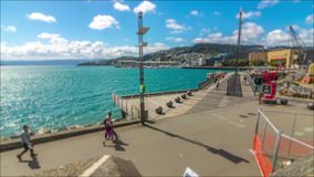 Time lapse, Wellington Waterfront tilt shift 4k. Bright tilt shift effect pedestrian traffic in Wellington New Zealand, no recognizable faces or logos stock video