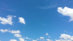 Time-lapse of the white cloud moving and transforming with the wind on the sunny day. Time-lapse of the white cloud moving and morphing with the wind in the stock footage
