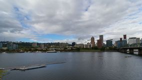 Time lapse of white clouds and blue sky over downtown skyline of Portland Oregon along Willamette River 4k stock video