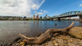 Time lapse of white clouds and blue sky over downtown skyline of Portland Oregon 4k uhd. Ultra high definition 4k time lapse video of moving white clouds and stock video footage