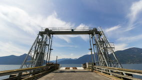Time Lapse of White Clouds and Blue Sky Over Ferry Dock at Porteau Cove Provincial Park in Vancouver British Columbia 1080p stock video
