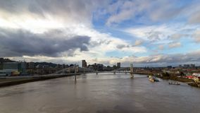 Time lapse of white clouds and blue sky over Tillikum Crossing and Marquam bridge in Portland OR 4k stock video
