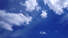 Time lapse of white clouds on blue sky.  stock footage