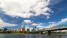 Time lapse of white clouds over downtown Portland Oregon with Hawthorne bridge 4k uhd. Ultra high definition 4k time lapse video of moving white clouds and blue stock video