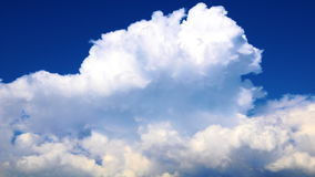 Time lapse white puffy clouds in deep blue sky stock video footage