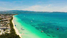 Boracay island with white sandy beach, Philippines. Timelapse. Time lapse: white sandy beach with turquoise water and tourists on Boracay Island, top view stock video