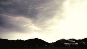 Time lapse of wickedly intense clouds roiling and flowing over peaks stock video
