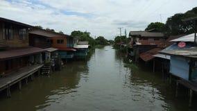 Time lapse of wooden house alongside canel ,Bangkok Thailand stock video
