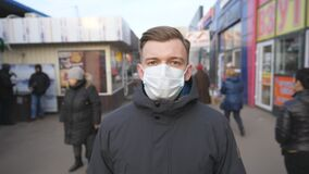 Time lapse of young man with medical face mask walking at city street. Guy wearing protective mask from virus outdoor in