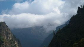 Clouds in the Himalayas. Time lapse zoom out. Beautiful clouds climb the mountain valley. Himalayas. Nepal stock footage