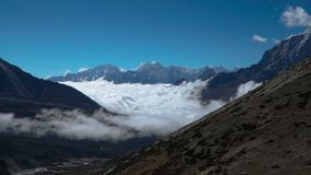 The movement of clouds over the highland valley. Time lapse zoom out. Beautiful clouds climb the mountain valley. Himalayas. Nepal stock footage