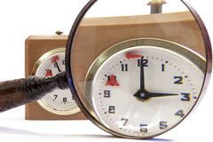 Time limit on analog chess clock enlarged through a magnifying glass Stock Photo