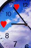 Time for love. Romantic clock with sky and two red hearts Royalty Free Stock Photo