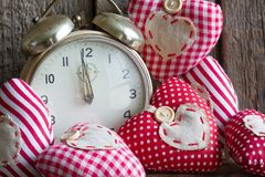 Time for love concept with alarm clock and handmade hearts Stock Image