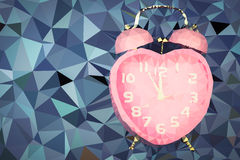 Time of love. pink alarm clock on the blue background. low polyg Royalty Free Stock Images