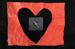 Time for Love. A Red Heart and a Clock Stock Photos