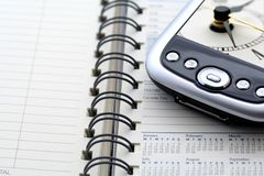 Time Management. Filofax PDA and pictre of clock stock image