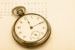 Time Management. A pocket watch sitting on a calendar background, time management Royalty Free Stock Image