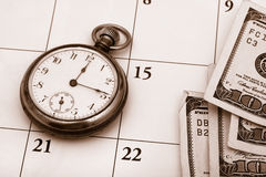 Time Management. A pocket watch sitting on a calendar background, time management Stock Images