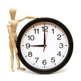 Time Management. A mannequin and clock are isolated on white to represent time management Stock Photography