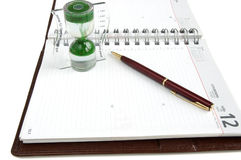 Time management. Concept time management, isolated diary, clock and pen on a white background Stock Images