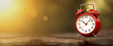 Time management banner. Time management concept - website banner of a vintage red alarm clock Royalty Free Stock Photography