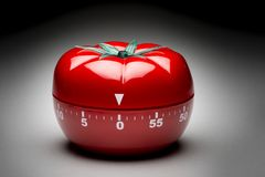 Tomato timer to fight procrastination. Stock Photos