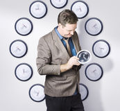 Time management business man looking at clock Royalty Free Stock Image