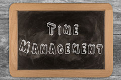 Time management - chalkboard with outlined text. On wood Royalty Free Stock Images