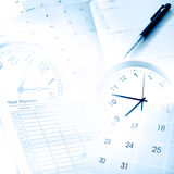 Time management. Clocks, calendars and diary pages Stock Photos