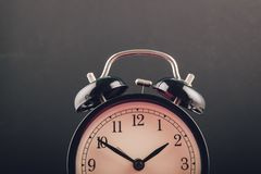 Time management concept, alarm clock on dark background. Copy space for text stock photo