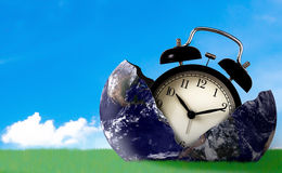 Time Management Concept. Business planning, The Earth and retro clock on green grass , Elements of this Image Furnished by NASA Stock Photo