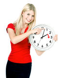 Time management concept. Daylight Saving Time. Young smiling wom. An with a clock stock photography