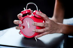 Time management. Concept hands holding clock Stock Photos