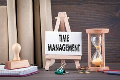 Time management concept. Sandglass, hourglass or egg timer on wooden table Royalty Free Stock Photos