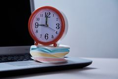 Time management deadline and schedule concept: alarm clock and laptop and sticky notes. Time management, deadline and schedule concept: alarm clock and laptop royalty free stock images
