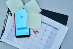 Time management deadline and schedule concept: calendar on the smartphone screen and stickers.  stock images