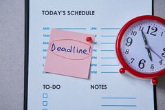 Time management deadline and schedule concept: hand made clock on grey background.  royalty free stock photos
